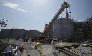 L'opérateur de la centrale nucléaire japonaise Fukushima Daiichi s'activait mardi pour relancer les systèmes de refroidissement des piscines de stockage du combustible, arrêtés depuis une panne de courant la veille au soir.