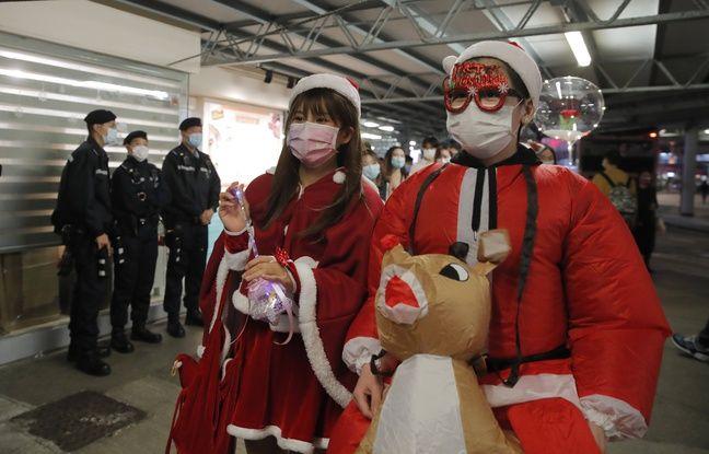 648x415 des habitants de hong kong avec un masque de protection contre le covid 19 le 24 decembre 2020