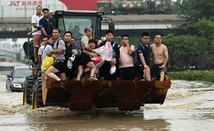 Des sinistrés des inondations mortelles qui ont frappé le centre de la Chine en début de semaine.