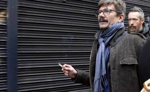 French cartoonist Luz arrives to attend a meeting gathering editorial staff of French satirical weekly newspaper Charlie Hebdo and Liberation, on January 9, 2015 in Paris, after a deadly attack that occurred on January 7 by armed gunmen on the Paris offices of Charlie Hebdo.  Two brothers suspected of slaughtering 12 people in the attack held one person hostage Friday as police cornered the gunmen northeast of the capital. AFP PHOTO / BERTRAND GUAY