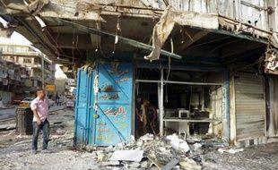 Au moins vingt personnes ont péri dimanche dans une série d'explosions de voitures piégées au sud de Bagdad, selon des responsables des services médicaux et de sécurité.
