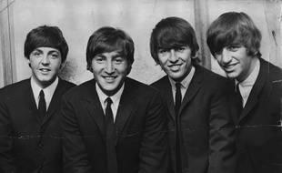 Les Beatles (Paul McCartney, John Lennon, George Harrison, Ringo Starr) en 1964.