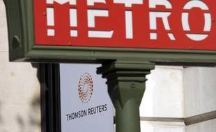 A plaque featuring the new logo for Thomson Reuters company is seen behind a Paris Metro sign on the facade of their Paris offices on Boulevard Haussmann April 17, 2008. Thomson Reuters Corp debuted on Thursday as a leading global information company, hoping a portfolio of products from financial to legal and health-care will help it ride out a financial industry downturn.    REUTERS/Mal Langsdon  (FRANCE)