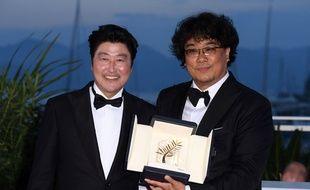 Song Kang-ho and Bong Joon-ho, Palme d'Or du Festival de Cannes, pour «Parasite», le 25 mai 2019.