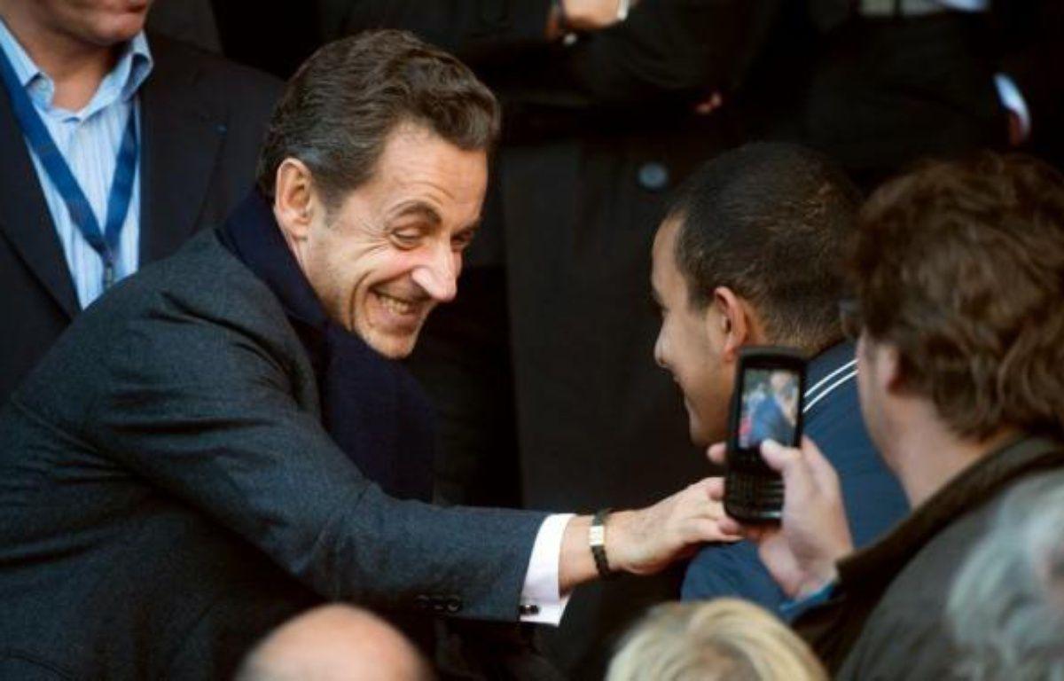 Près d'un Français sur deux (49%) souhaiterait voir Nicolas Sarkozy aujourd'hui à l'Elysée, tandis que 46% se prononcent pour François Hollande, selon un sondage Harris Interactive pour Marianne diffusé samedi. – Bertrand Langlois afp.com