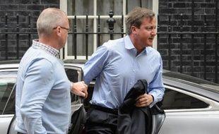 Le Premier ministre britannique David Cameron de retour à son bureau du 10 Downing Street, dans le centre de Londres le 20 août 2014