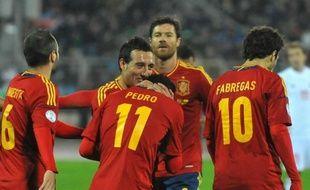 La Russie (GrF) a piégé le Portugal (1-0), vendredi dans ce choc des qualifications du Mondial-2014 de la zone Europe, tandis que l'Espagne s'est promenée au Bélarus (4-0) avec un triplé de Pedro (GrI), tout comme l'Allemagne sur la pelouse de l'Eire (6-1) dans le groupe C.