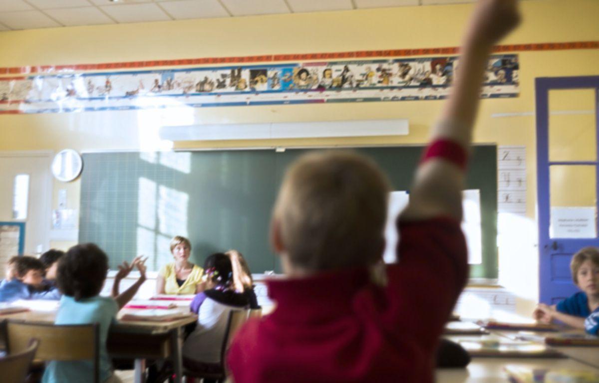 Un enfant en classe à Paris en 2012. –  FRED DUFOUR