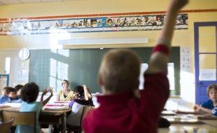 Un enfant en classe à Paris en 2012.