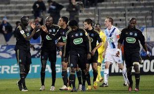 L'Olympique de Marseille, longtemps mené et malmené, a obtenu une qualification laborieuse (3-1) après prolongation, dimanche en 16e de finale de la Coupe de France, aux dépens d'une équipe du Havre (L2) qui pourra regretter plusieurs balles de match mal négociées.