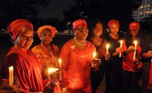 Des bougies sont allumées lors d'une manifestation pour réclamer la libération des lycéennes enlevées par Boko Haram, le 12 octobre 2014 à Abuja