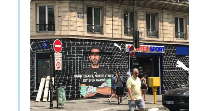 9cf1ef796b6 After the ad is vandalized in the colors of the OM, Intersport and Puma  show Gigi Buffon