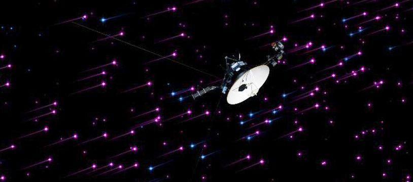 Vue d'artiste de la sonde Voyager 1, aux confins du système solaire.