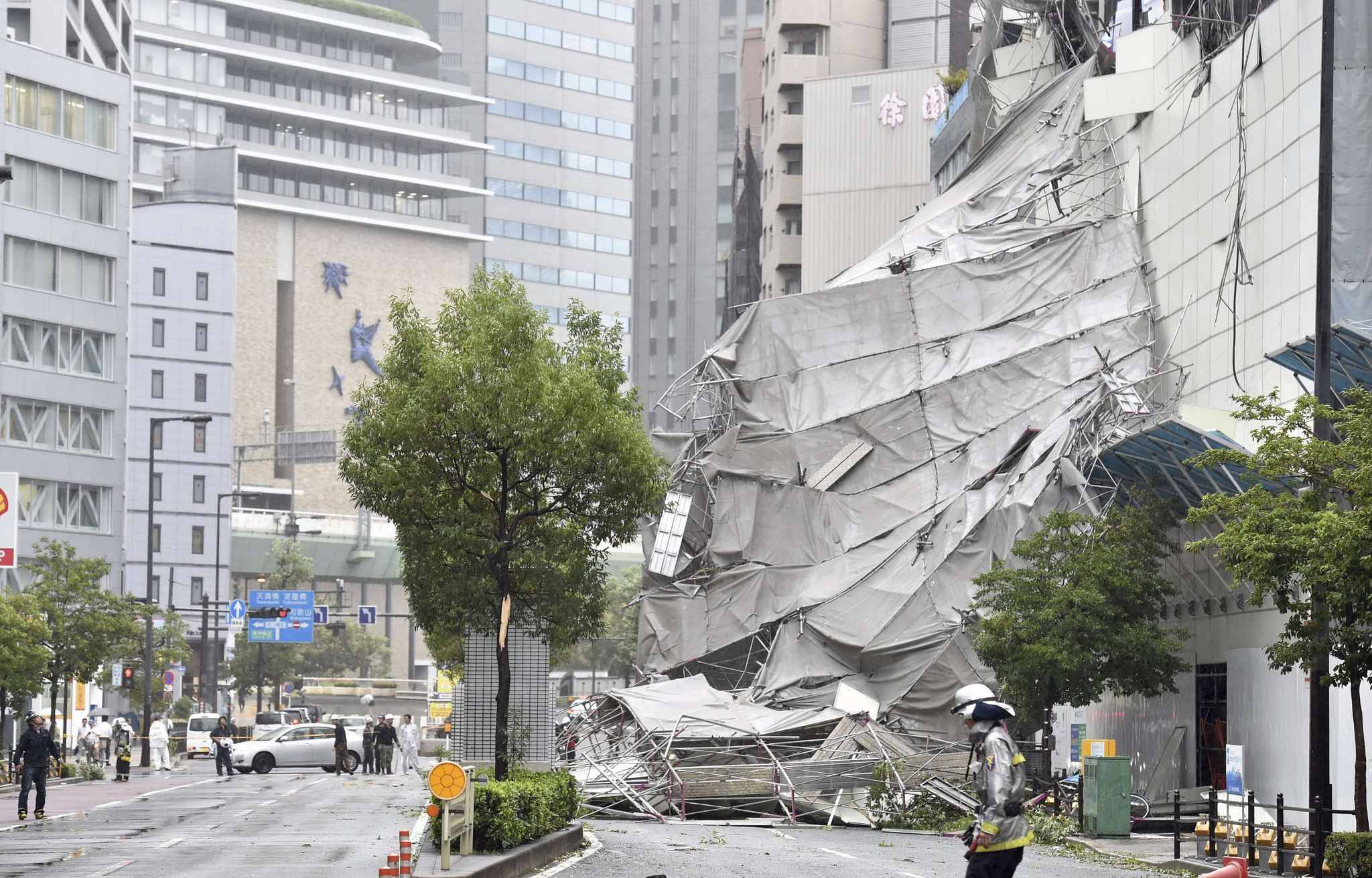 Damaged walls at construction site due to a strong wind triggered by Jebi is pictured in Osaka on Sep.4, 2018. Powerful typhoon made a landfall on Tokushima Prefecture in noon and expected to proceed to the Sea of Japan. Violent winds, high waves and heavy rains are forecasted in wide area of Japan till next day.