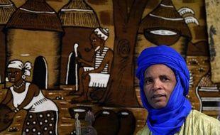 Un homme fait la promotion du Mali au salon ITB de Berlin le 5 mars 2015