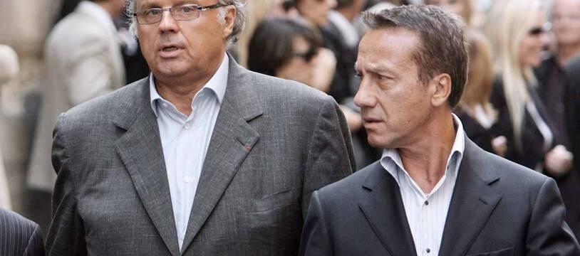 Le producteur Gérard Louvin et son époux.