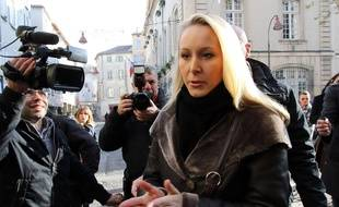 Far right National Front party regional leader for southeastern France, Marion Marechal-Le Pen leaves a polling station after voting, in Carpentras, southern France, Sunday, Dec.13, 2015. Marine Le Pen's anti-immigration National Front was the frontrunner heading into the decisive second round of French regional elections Sunday, and now it's up to voters whether to hand the once-pariah party an unprecedented political victory. (AP Photo/Claude Paris)/CAR102/588736329524/1512131228