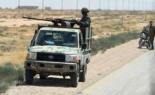 Des soldats syriens patrouillent près de Palmyre en Syrie (Illustration).