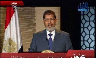 """Le président élu Mohamed Morsi, premier islamiste à accéder à la magistrature suprême en Egypte, a promis dimanche d'être le président de """"tous les Egyptiens"""", en appelant à l'unité nationale et en promettant de respecter les traités internationaux signés par son pays."""