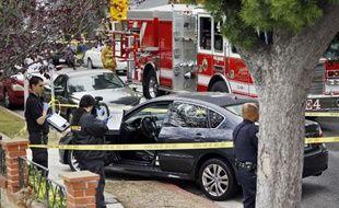 Un homme armé d'un fusil d'assaut a tué au moins six personnes à Los Angeles, le 7 juin 2013 avant d'être abattu par la police.