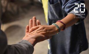 Illustration de deux personnes se touchant la main