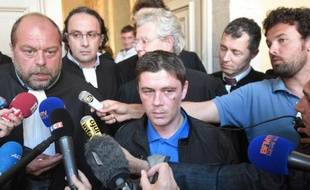 Daniel Legrand (D) et son avocat Eric Dupond-Moretti au palais de justice lors de son procès le 4 juin 2015 à Rennes