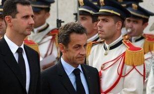 """""""Avec le président Bachar al-Assad, nous construisons pas à pas une relation de confiance pour tourner la page"""" des désaccords, a affirmé M. Sarkozy lors d'un point de presse commun au palais présidentiel, au premier jour de visite dans la capitale syrienne."""