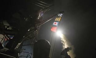 Frappe américaine en Syrie: le destroyer USS Ross tire des missiles Tomahawk depuis l'Est de la Méditerranée, le 7 avril 2017.