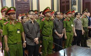 Des membres du groupe d'opposants au pouvoir politique vietnamien jugés le 22 août 2018.