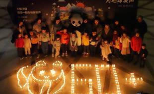 Des bougies allumées en Chine pour l'opération « Earth Hour », le 27 mars 2021.