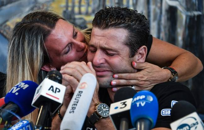 Franky Zapata is kissed by his wife Krystel as he sheds a tear during a press conference on August 4, 2019 in Sangatte after he succeeded earlier today on his second attempt to cross the English Channel on a jet-powered