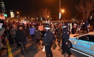 Des manifestants protestent contre les violences policières, le 4 décembre 2014 à New York