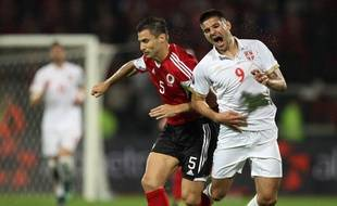 Albania's Lorik Cana (L) vies with Serbia's Aleksandar Mitrovic during the Euro 2016 qualifying football match between Albania and Serbia at the Elbasan Arena in Elbasan on October 8, 2015. AFP PHOTO / GENT SHKULLAKU