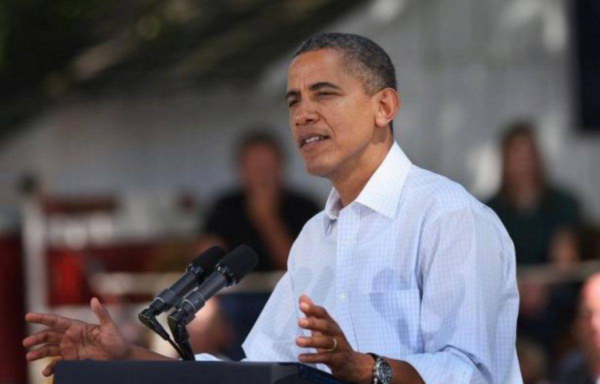 Barack Obama et Mitt Romney se sont affrontés à distance mardi sur les questions d'énergie alors que les deux candidats à la présidentielle américaine effectuent chacun un périple en bus dans des Etats clés en vue du scrutin du 6 novembre. – Scott Olson afp.com