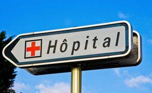 Un panneau indiquant la direction d'un hôpital. Illustration.