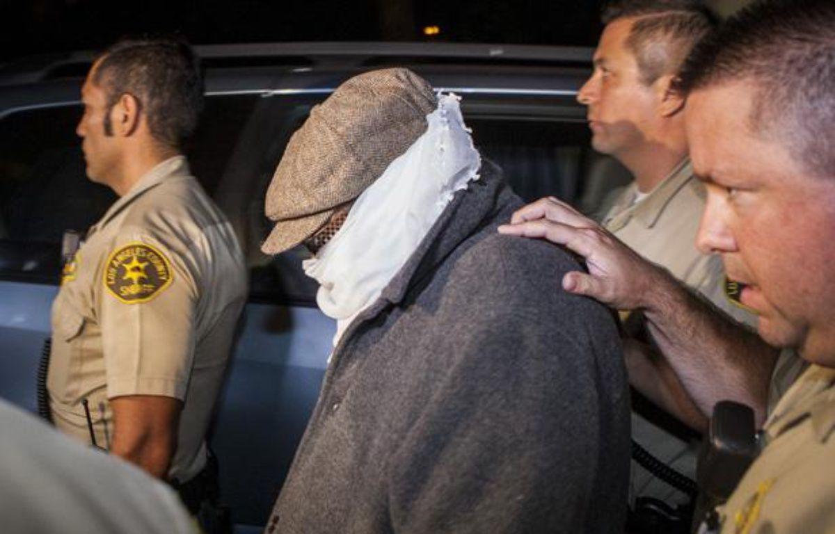 Un responsable de la production du film anti-islam, Nakoula Basseley Nakoula, conduit par la police, le 15 septembre 2012. – B.HARTMAN / REUTERS