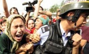 Une manifestation de femmes ouïgoures  à Urumqi (Xinjiang), le 7 juillet dernier.