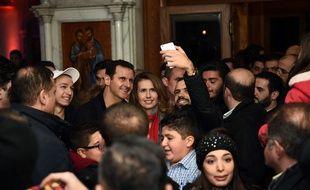 Bachar al-Assad et sa femme se sont rendus dans une église de Damas, le 18 décembre 2015.