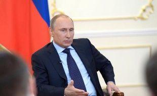 Le président russe Vladimir Poutine le 4 mars 2014 lors d'une rencontre avec des journalistes dans sa résidence dans la banlieue de Moscou