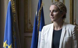 Au lendemain des législatives, le président François Hollande et le Premier ministre Jean-Marc Ayrault ont remanié jeudi l'équipe gouvernementale en changeant les attributions de certains ministres et en la renforçant de quatre nouveaux membres.
