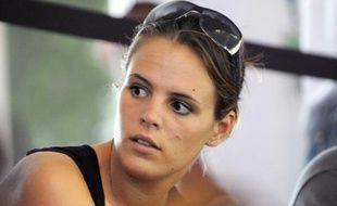 """Le directeur technique de la Fédération française de natation, Christian Donzé, a indiqué mardi que Laure Manaudou, qui s'entraîne aux Etats-Unis afin de retrouver éventuellement le haut niveau, progressait """"de semaine en semaine""""."""