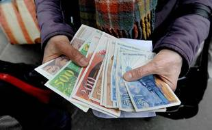 Illustration de billets en francs, ici en 2012.