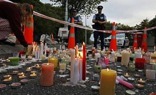 Le 18 mars 2019,des bougies en mémoire des victimes de Christchurch. AP Photo/Vincent Yu