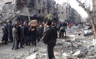 Distribution d'aide alimentaires aux réfugiés du camp de Yarmuk le 24 mars 2014 en Syrie