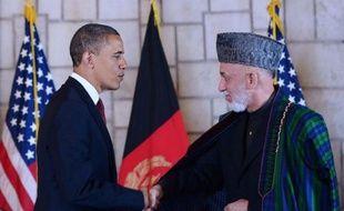 Le président américain Barack Obama a signé dans la nuit de mardi à mercredi un accord stratégique à long terme avec son homologue afghan Hamid Karzaï lors d'une visite surprise à Kaboul, un an pile après l'élimination d'Oussama Ben Laden