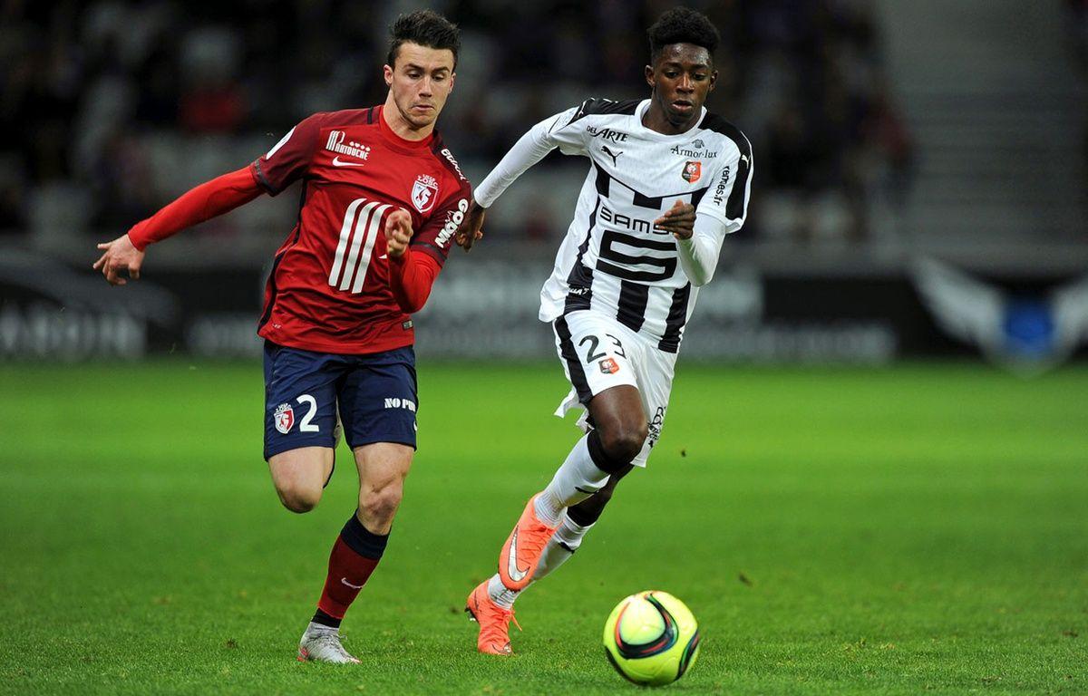 Ousmane Dembélé (à d.), ici à la poursuite du Lillois Sébastien Corchia, a évité une 3e défaite consécutive aux Rennais. – F. Lo Presti / AFP
