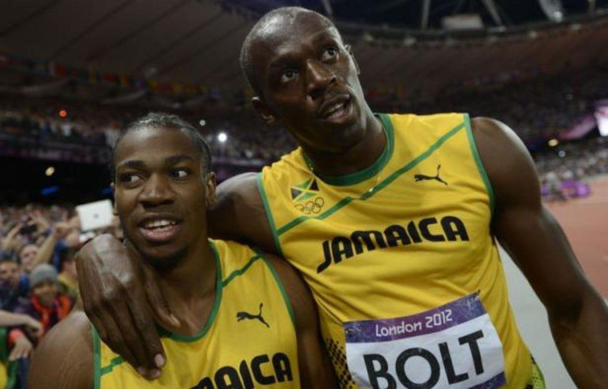 Le triomphe d'Usain Bolt sur le 100 m des jeux Olympiques dimanche aurait été bien suffisant pour beaucoup de pays mais la Jamaïque, qui a fêté lundi les 50 ans de son indépendance, n'est pas rassasiée et rêve maintenant d'un triplé sur le 200 m. – Adrian Dennis afp.com