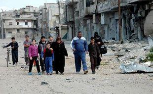Régime syrien et militants se sont accusés mutuellement dimanche du massacre d'une dizaine de civils, dont plusieurs femmes, dans la ville de Tall Kalakh, près de la frontière avec le Liban.