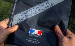 """La suppression de la première tranche de l'impôt sur le revenu, annoncée par Manuel Valls le 17 septembre comme une réponse au """"haut-le-coeur fiscal"""" des Français, sera la mesure fiscale phare du budget 2015"""