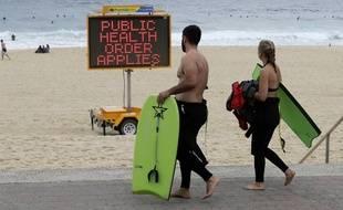 Les messages sanitaires jusque sur la plage à Syndey alors que l'été austral commence.